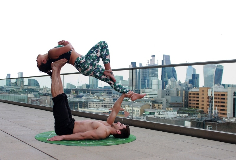 Teaching acro yoga is one of the best travel jobs for yogis