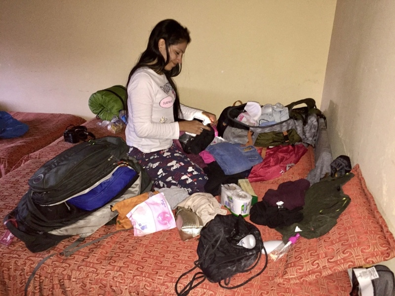 Travel packing done wrong—clothes dumped all over bed