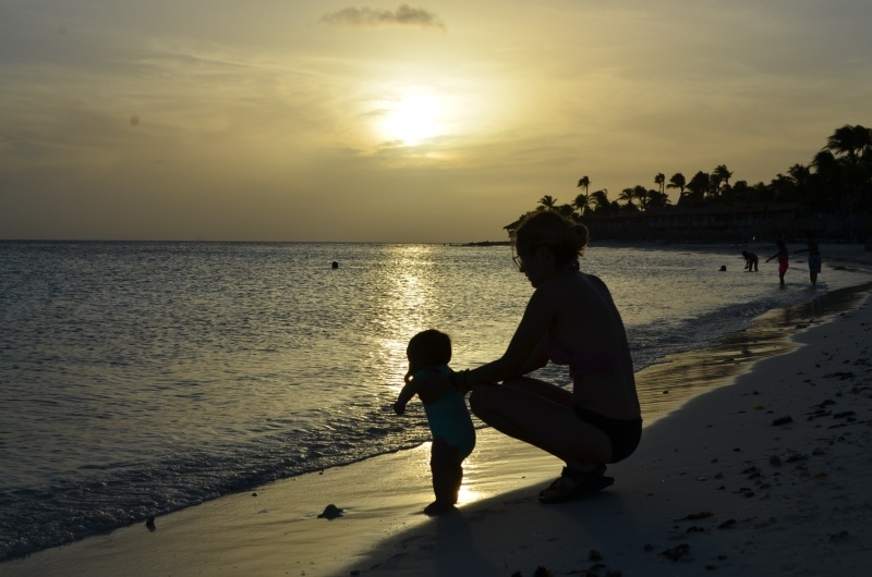 Mom and infant on beach in Curacao