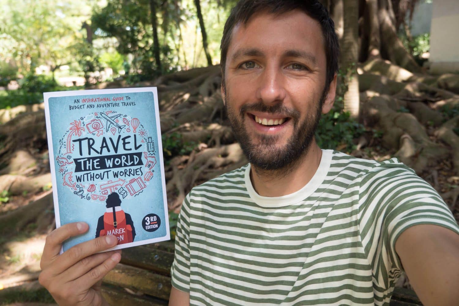 "Indie Traveller showing off his new ""how to travel"" book"