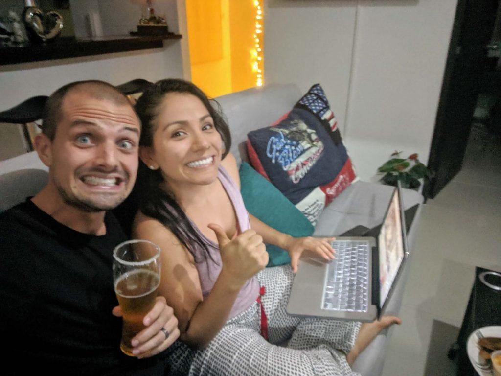My wife and I buying our one-way ticket to start our life of travel