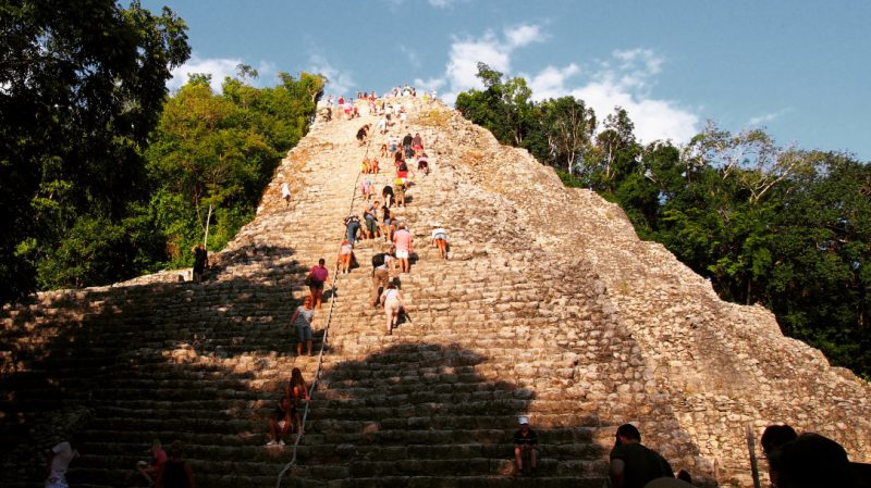 Climbing the Nohoch Mul Pyramin at Coba, Mexico