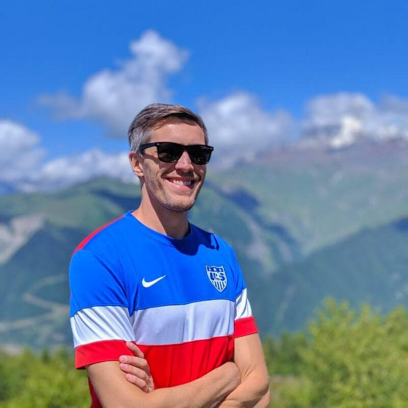 Traveler smiling with mountain background in Georgia