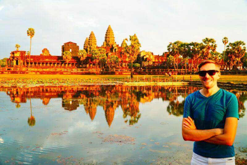 Traveler posing with Ankor Wat in background