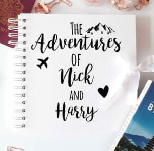 Personalized adventure scrapbook with name of couple