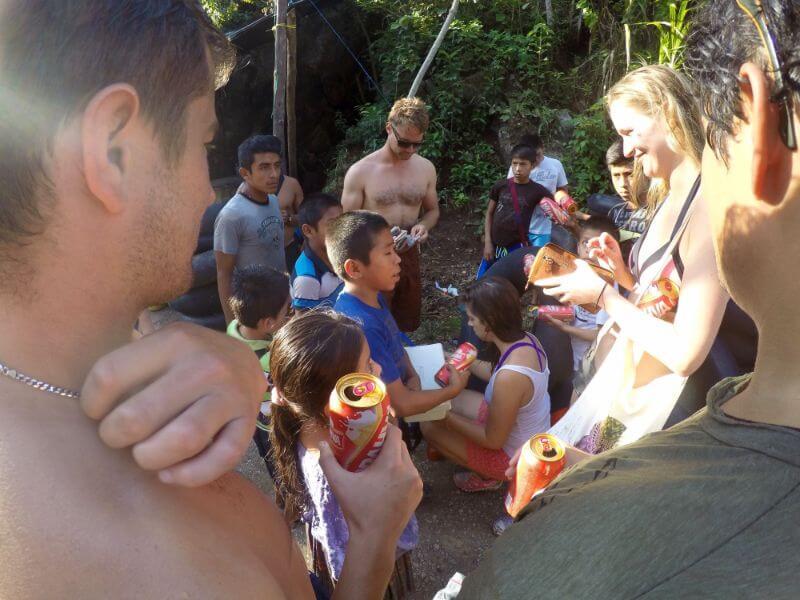 Kids selling beer at Semuc Champey, Guatemala