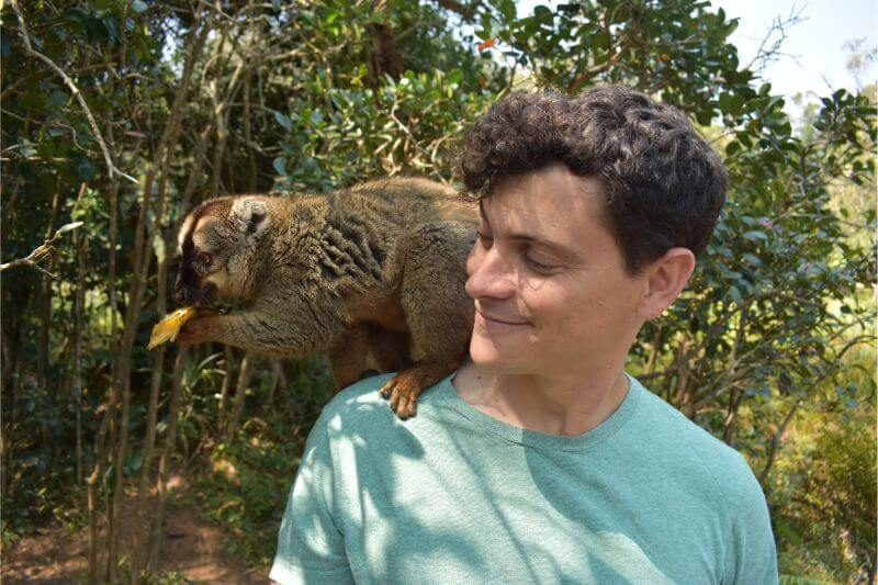 Nomadic Matt (Matt Kepnes) with a monkey on a safari