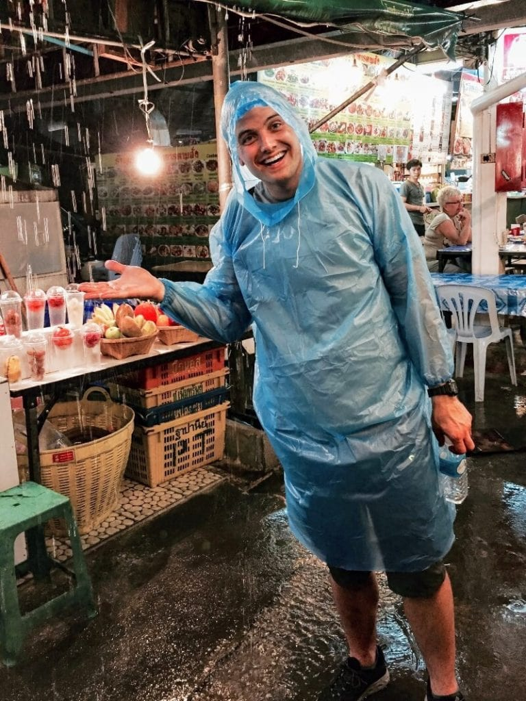 man wearing poncho - what it looks like when you plan your chiang mai itinerary during rainy season