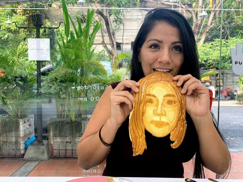 eating a personalixzed face pancake in Chiang Mai, Thailand