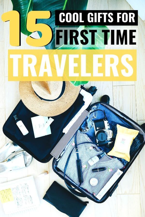open suitcase on the floor with text overlay 15 cool gifts for first time travelers