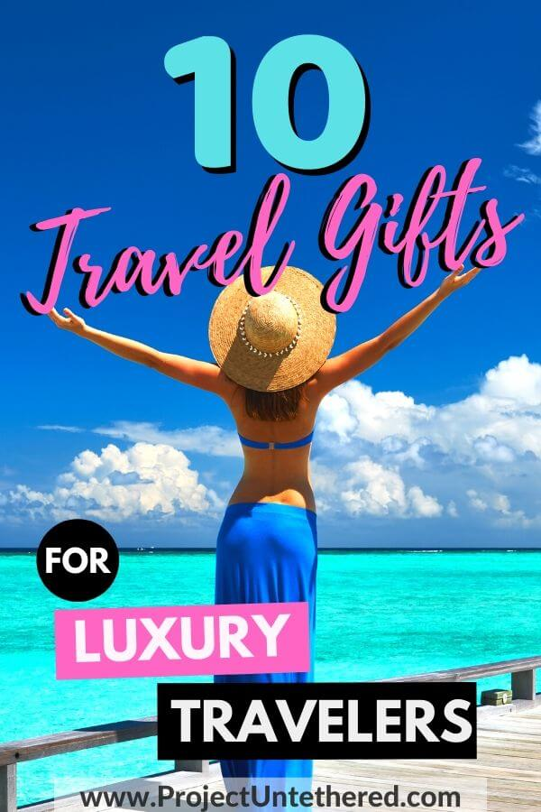 women looking over blue water with text overlay 10 travel gifts for luxury travelers