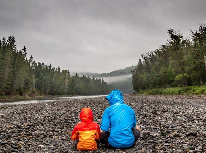 travel gifts for dad feature image - dad and son sitting in the forest