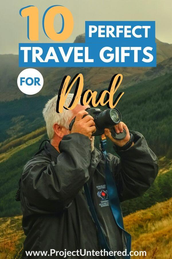 man using camera with text overlay 10 perfect travel gifts for dad