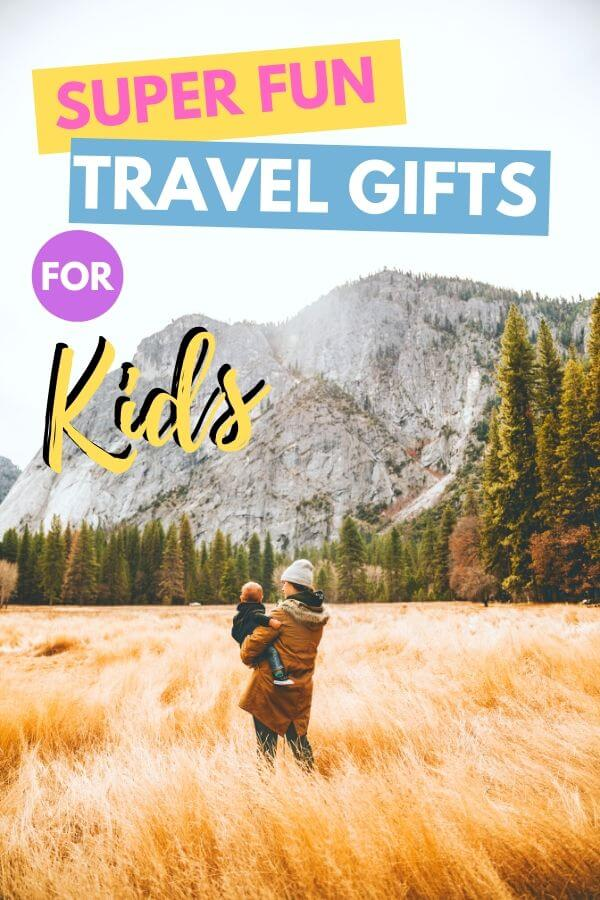 mom with baby in field with text overlay super fun travel gifts for kids