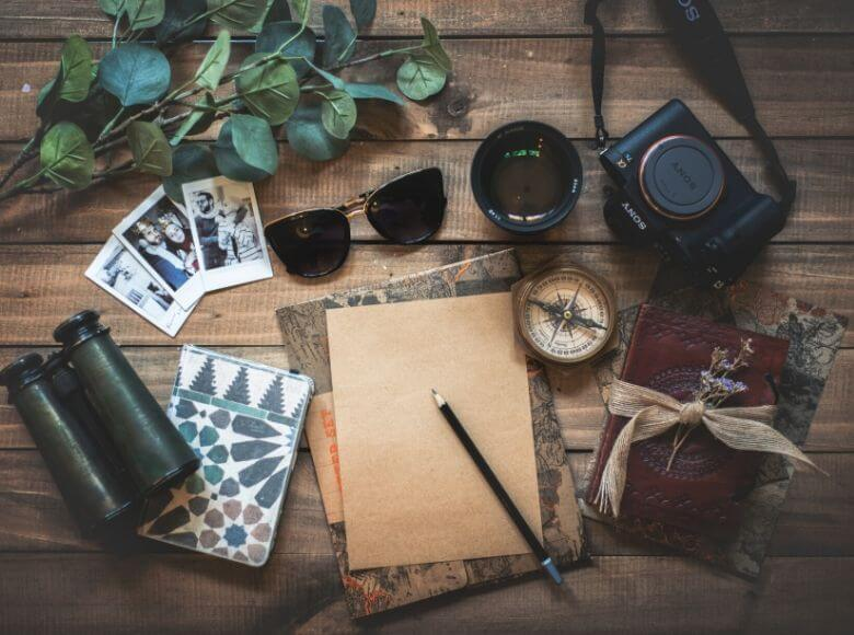 travel gifts for mom feature image - travel gear laid out on table