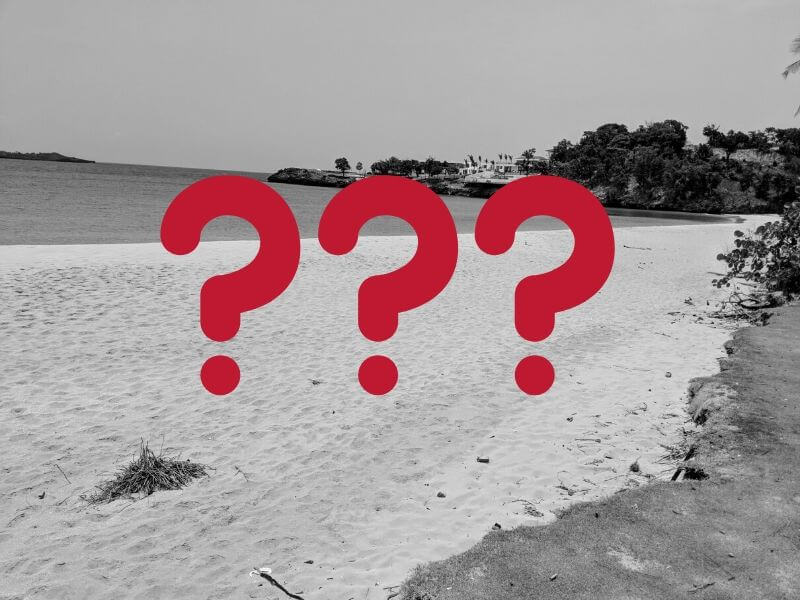 mystery beach with question marks