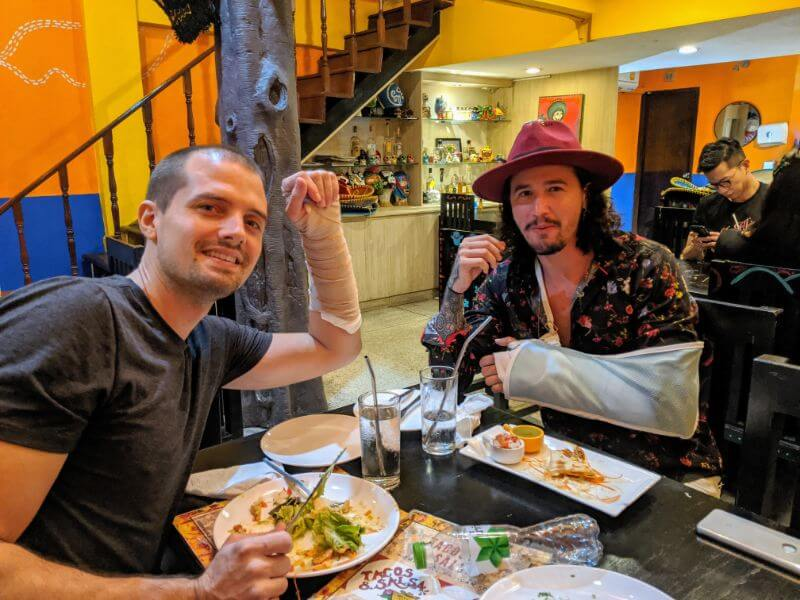 two guys with broken wrists from motorcycle accidents in Thailand