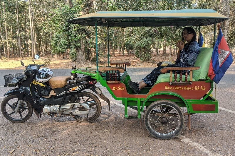 woman sitting in Cambodian tuk-tuk while visiting Angkor Wat