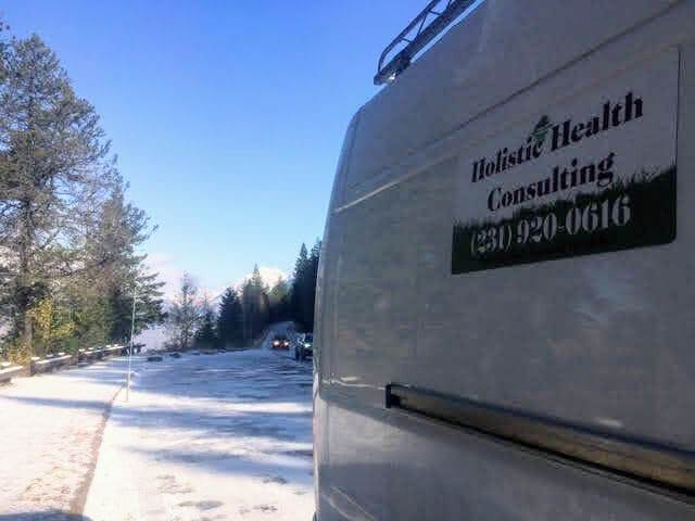 van with holistic health services ad on side