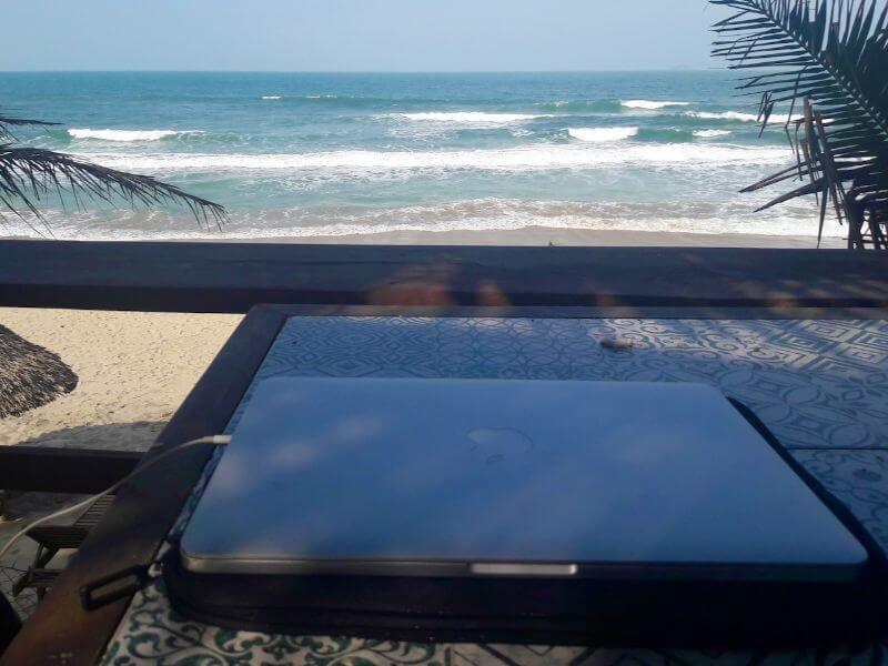 content writing on laptop at the beach