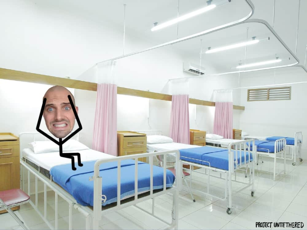 graphic of stick guy laying in a hosptial bed stressed because he doesn't have digital nomad health insurance