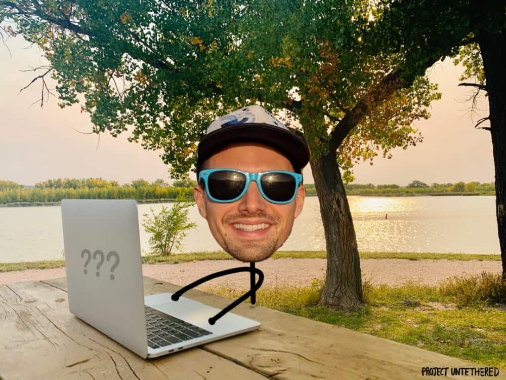 laptop set on a table with lake background