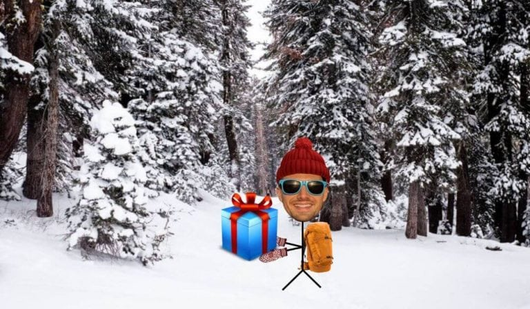 stick guy carrying travel gifts through the snow