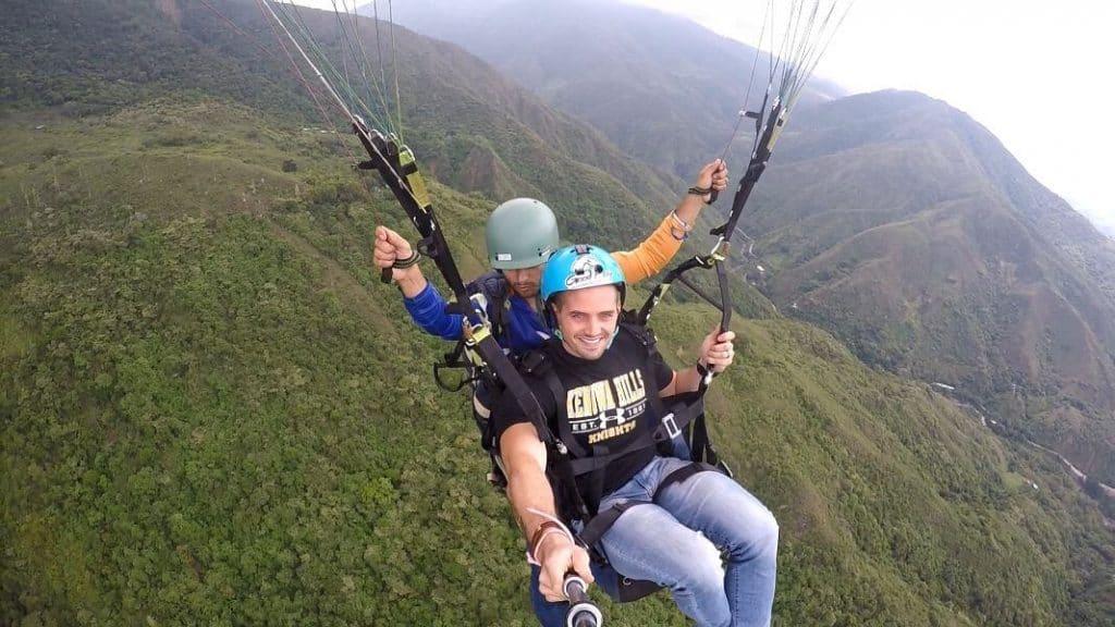man paragliding in panajachel guatemala