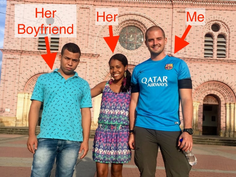 gringo posing with a colombian girl and her boyfriend