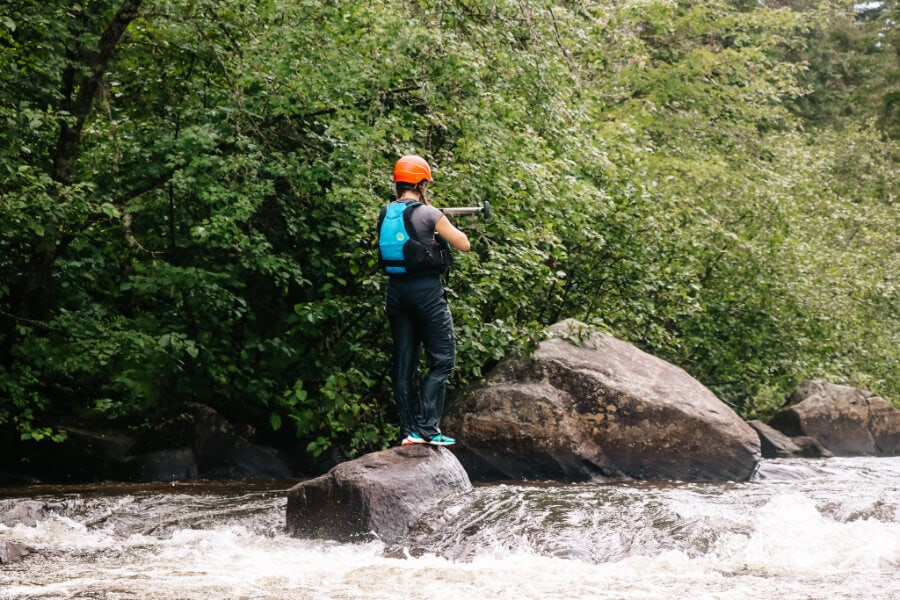 whitewater canoeing guide gauging the river