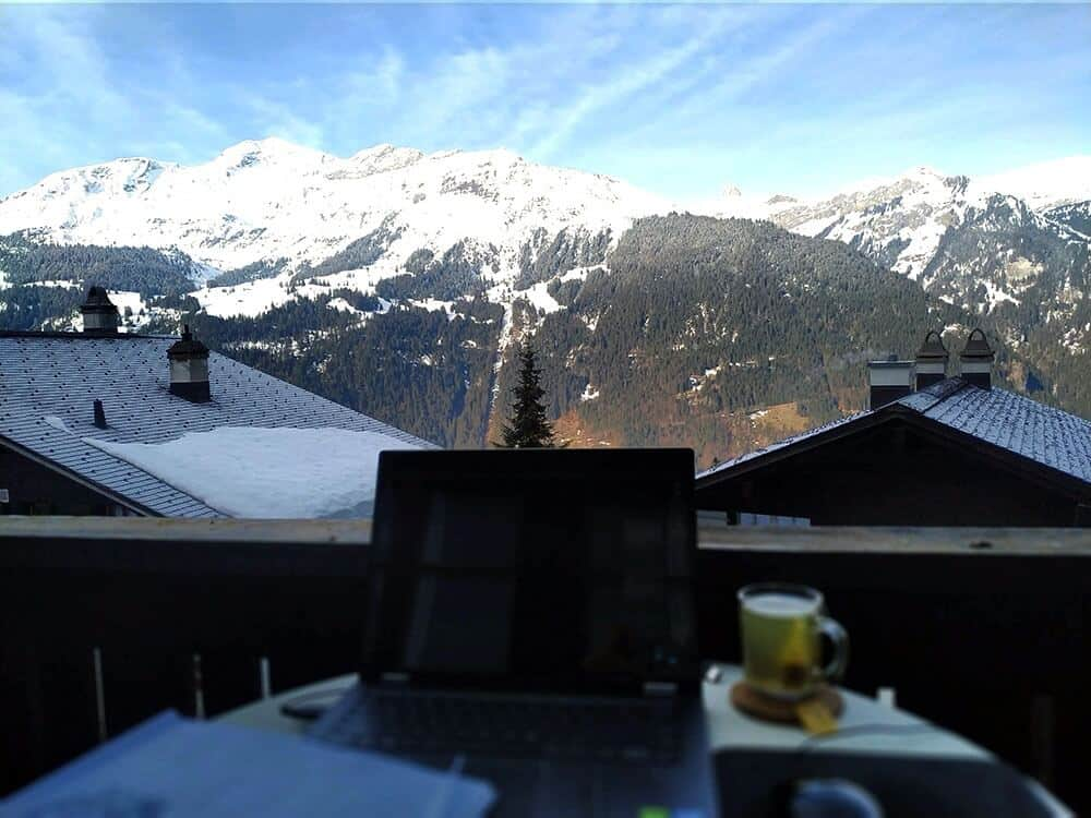 working from laptop with view of the mountains