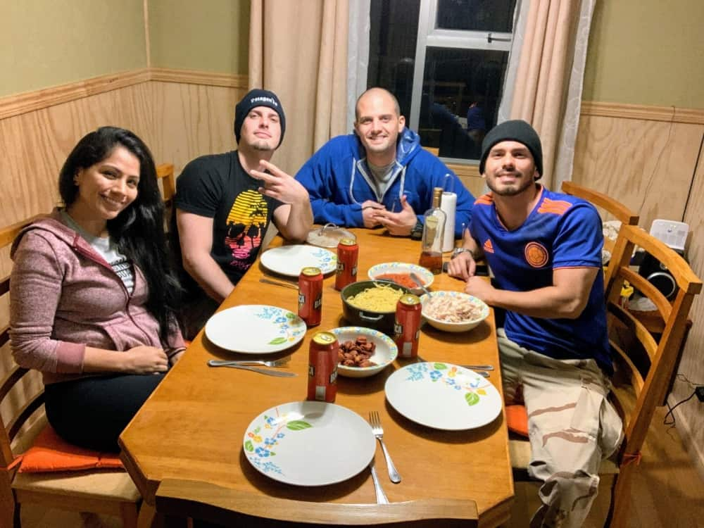 four travelers eating dinner at a shared airbnb in patagonia