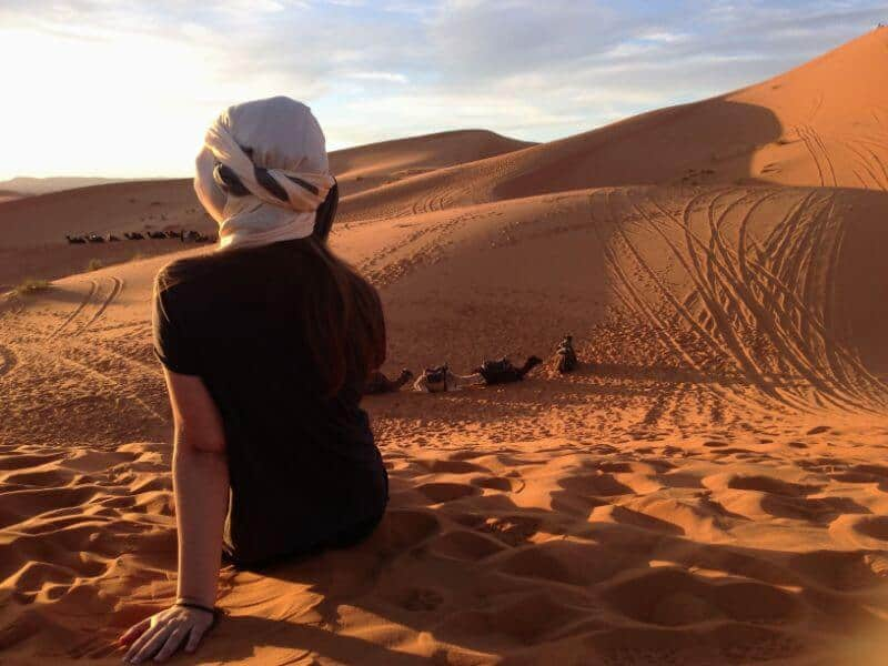watching the sunset in the Sahara desert in Morocco