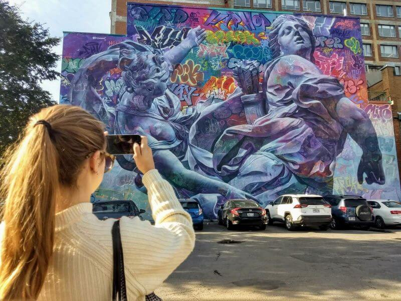 taking pictures of murals in Montréal in Canada