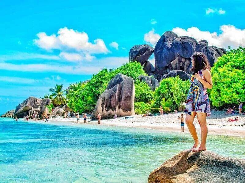 digital nomad girl on Seychelles beach