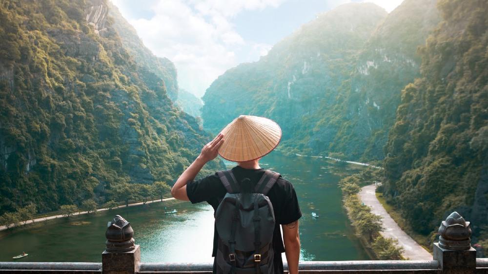 man exploring river in asia