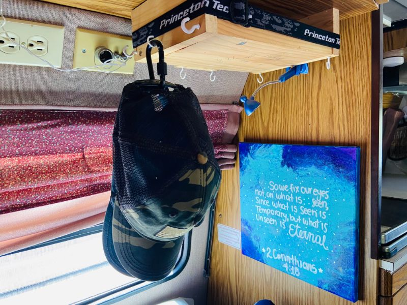 hats organized in RV using hooks and carabiners