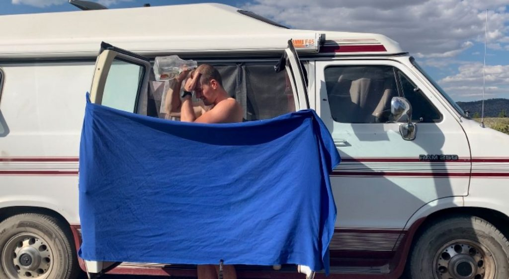 tips for van life showering showing towel on doors held up by magnets