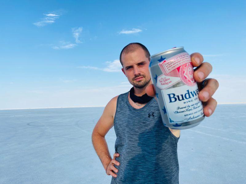 man holding beer on Bonneville Salt Flats in Utah