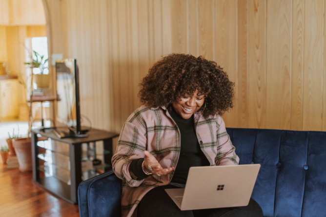 woman using laptop to get paid to be an online friend