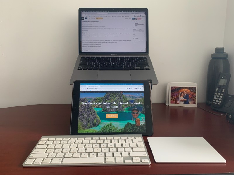 portable home office setup with two screens that aren't level